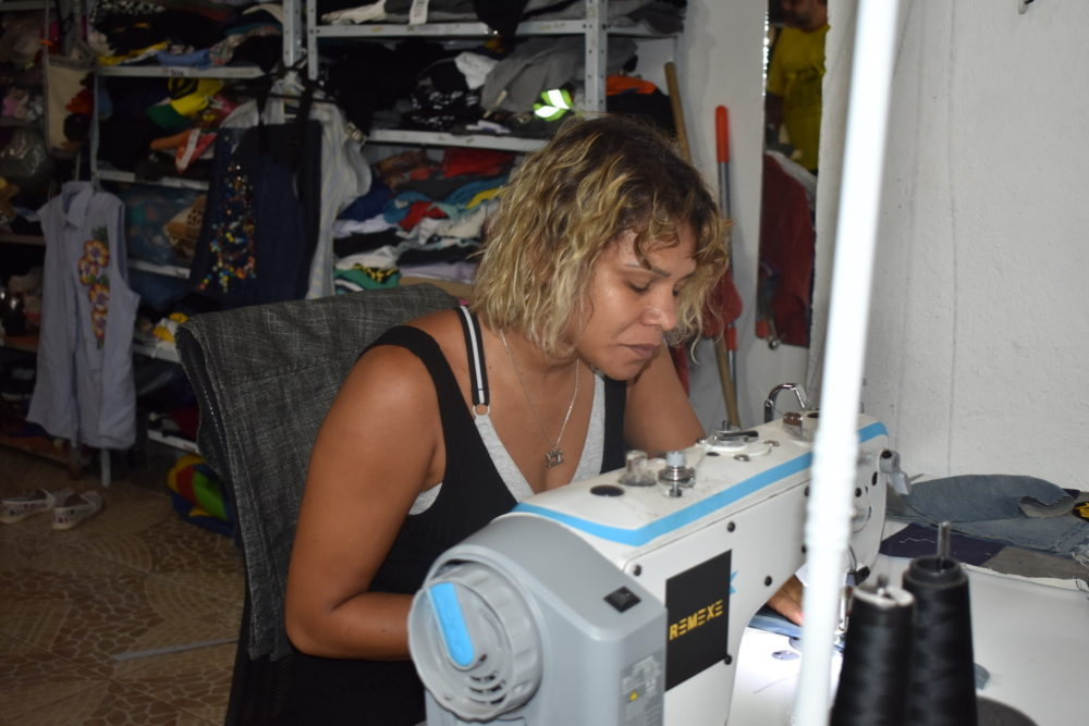 A seamstress at La de Favelinha