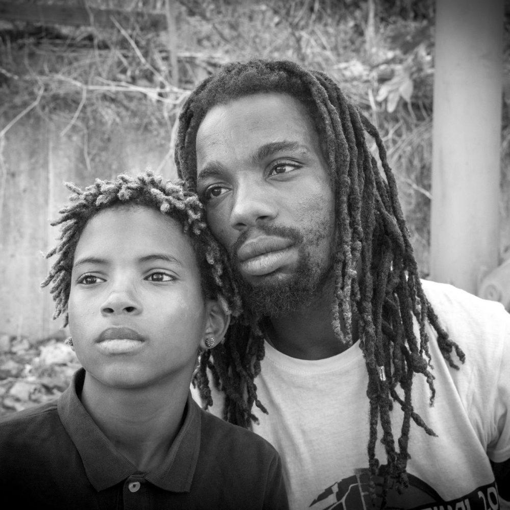 Mima, our guide in Cova da Moura, with his son.