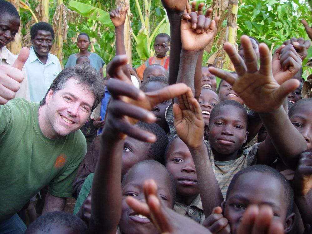 Béla with kids in Uganda