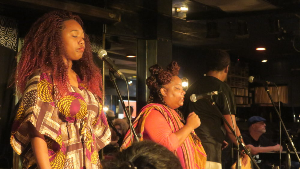 Marie-Claude (center) sings with her husband Fabrice (right) and cousin (left).
