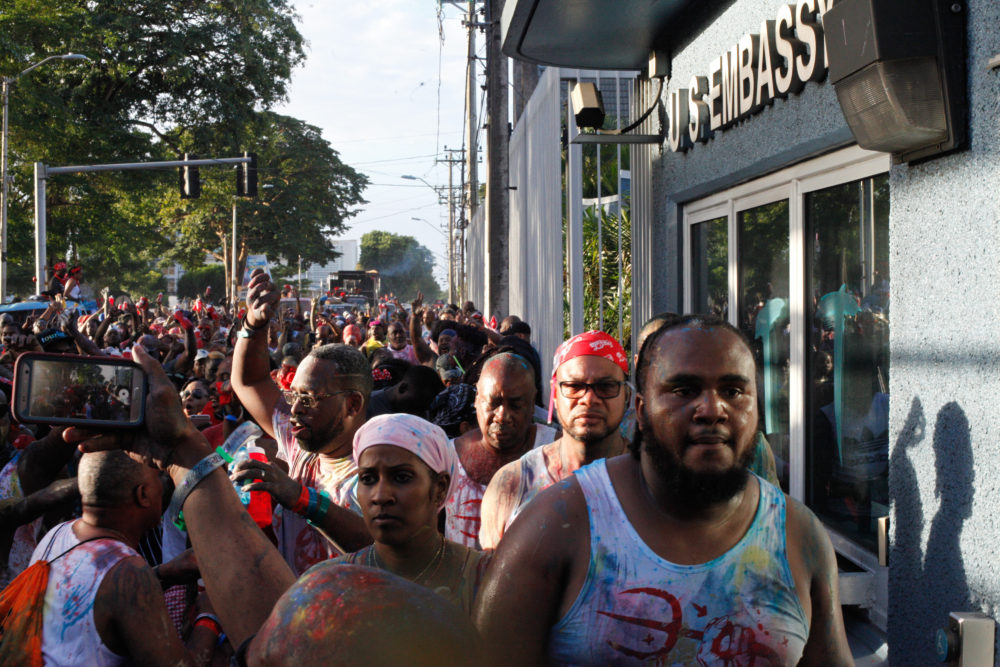 J'Ouvert passes the U.S. Embassy in Port of Spain