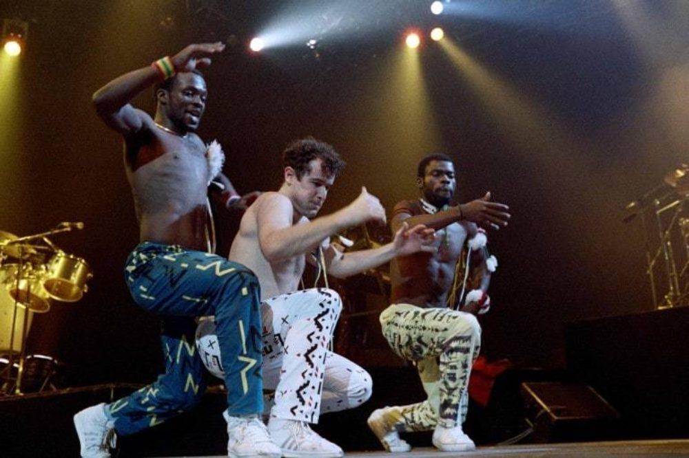 Johnny and Dudu Zulu (far left)