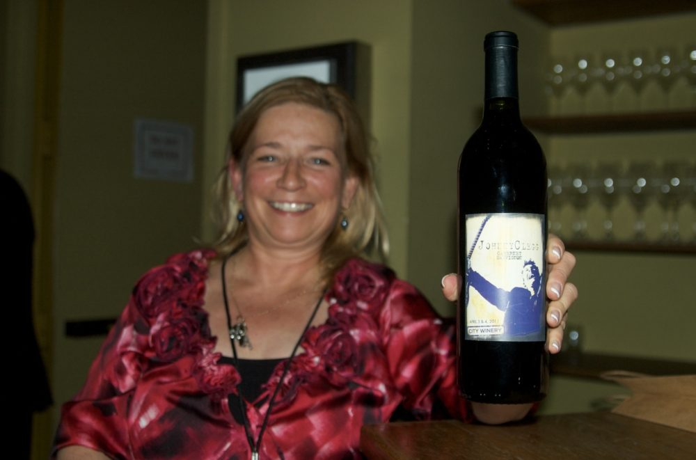 Johnny's U.S. agent Anne Marie Martins with Johnny Clegg-label wine!