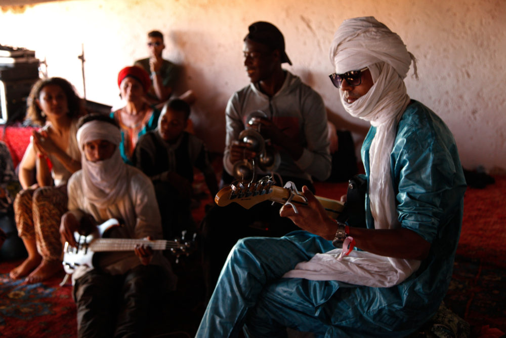 Young musicians from the local Joudour Sahara music school jam in the afternoon at Taragalte.