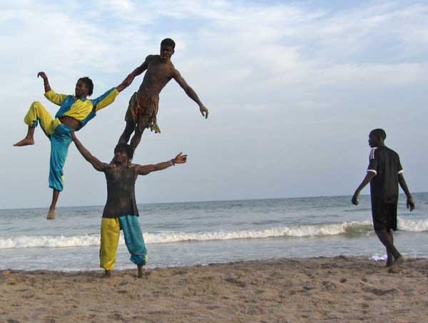 Acrobats at Labadi Beach (Eyre 2013)