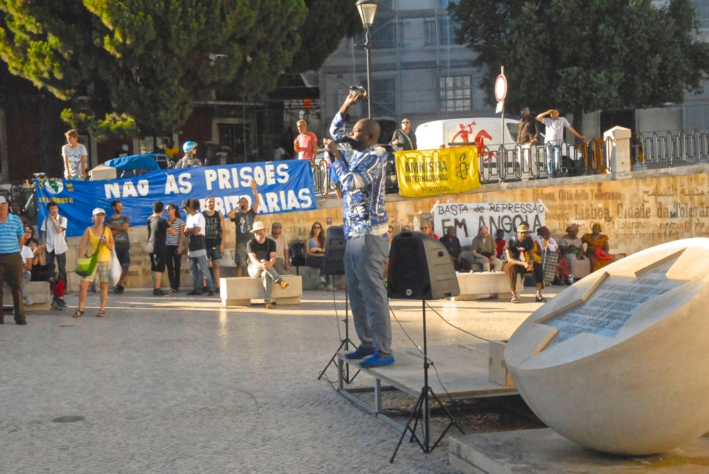 Speakers at a protest against the government of Angola.