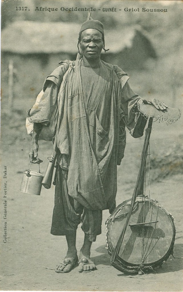 This image shows a griot (musician and storyteller) with his kora (calabash harp). It is the work of Edmond Fortier, a French photographer who spent nearly 30 years working in West Africa, mainly Senegal, in the early 20th century.