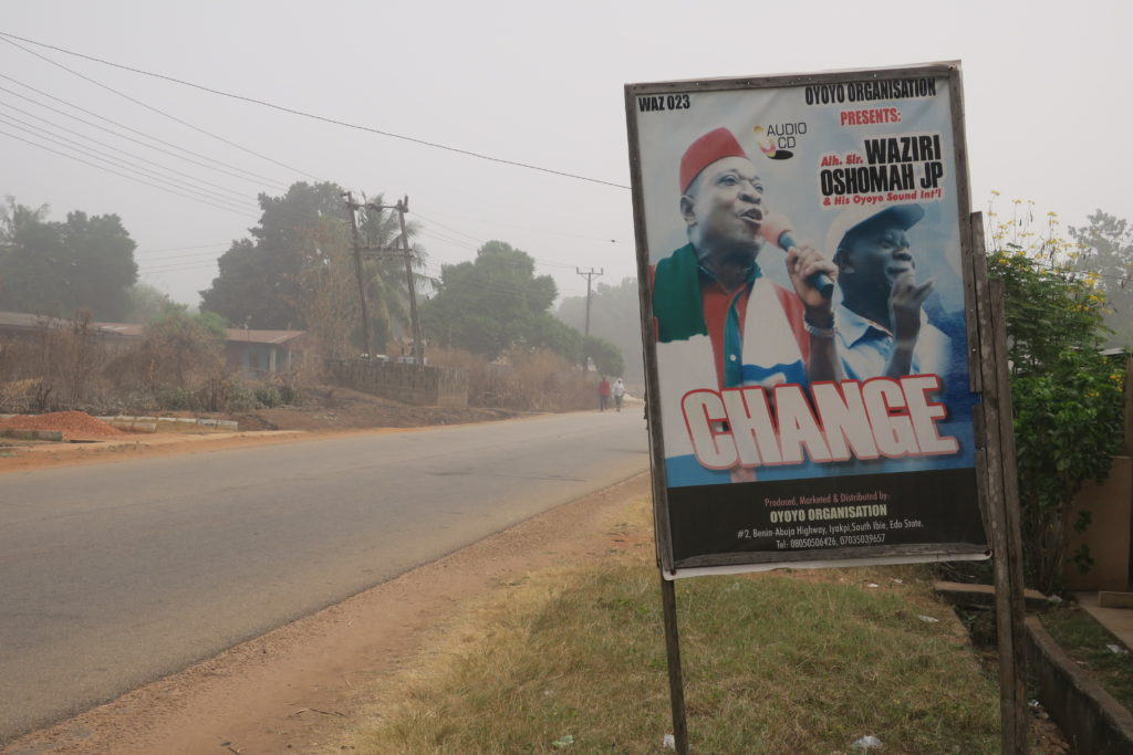 A signboard for Alhaji Waziri Oshomah's album Change, pictured with Adams Oshiomole