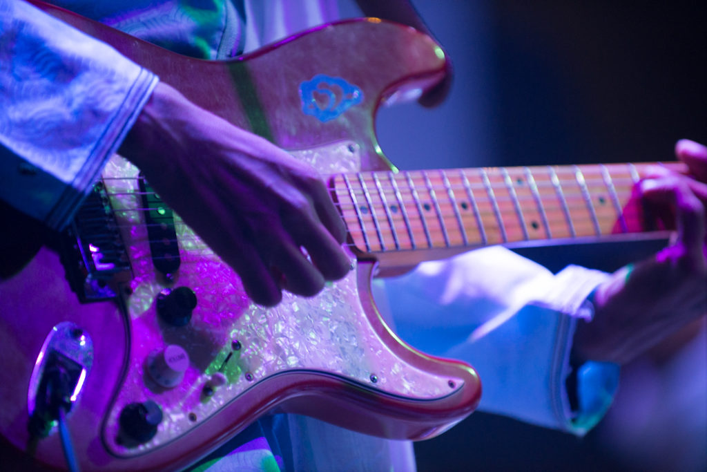 Mdou Moctar's hands on his guitar